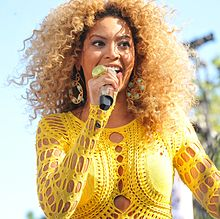 Beyonce Knowles singing in Central Park, New York, 2011