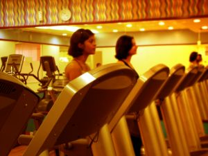 Inside a gym, people on treadmills