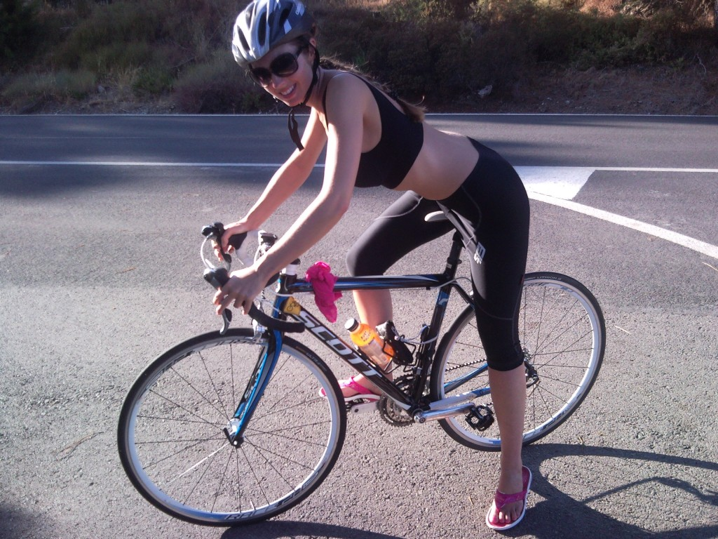 Woman cycling on a racing bike